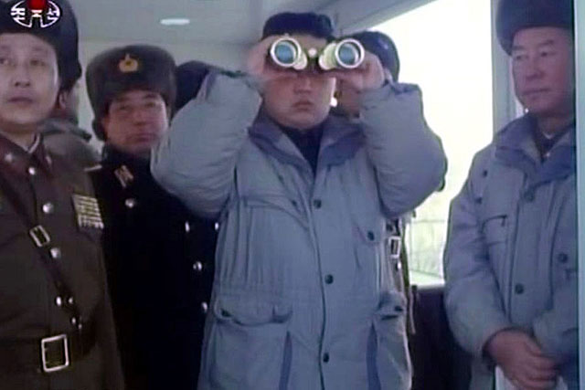 kim Jong Un Looking through binoculars