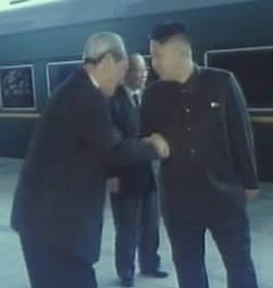 Kim jong un shaking hands