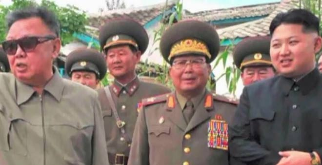 Kim Jong Un looking at glasses