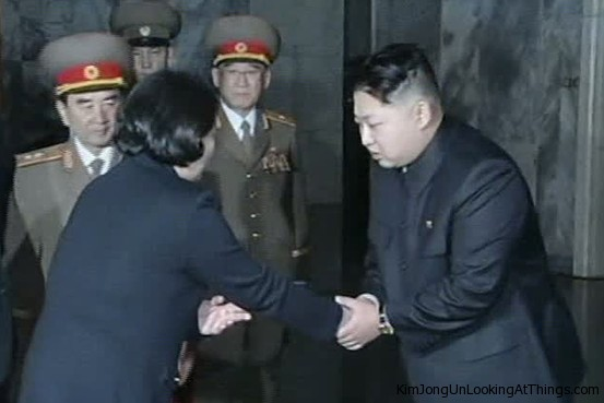 kim jong un looking at hyun jeong-eun