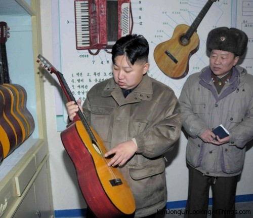 kim jong un looking at guitar