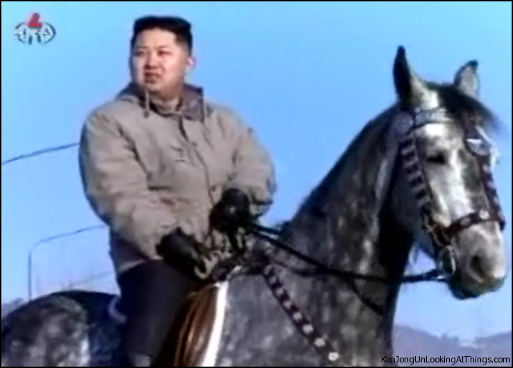 kim jong un looking at horse