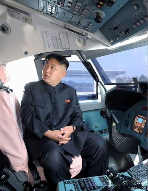 kim jong un lookign at plane