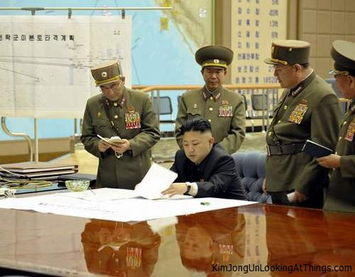 kim jong un looking at plans