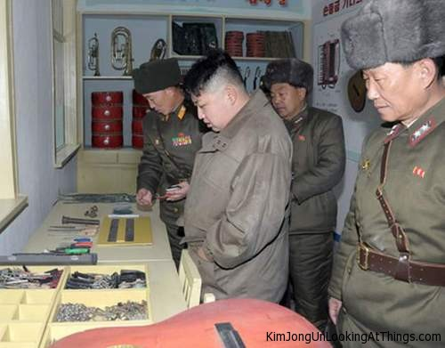 kim jong un looking at workbench