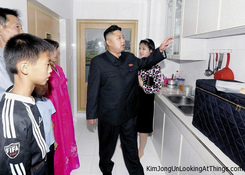 kimg jon un looking at cabinet