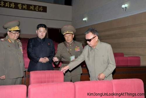 kim jong un looking at a movie chair