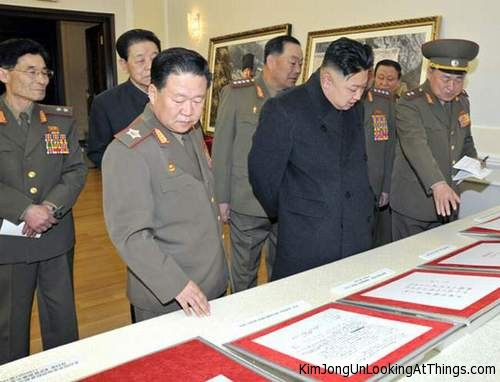 kim jong un looking at documents