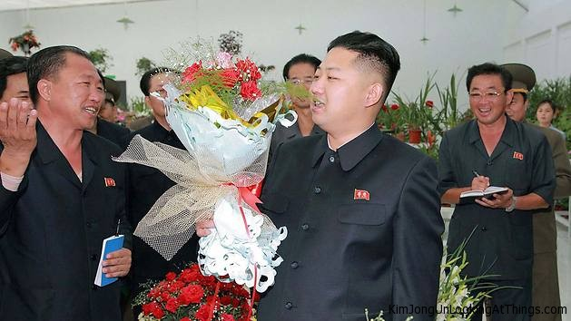 kim jong un looking at flowers