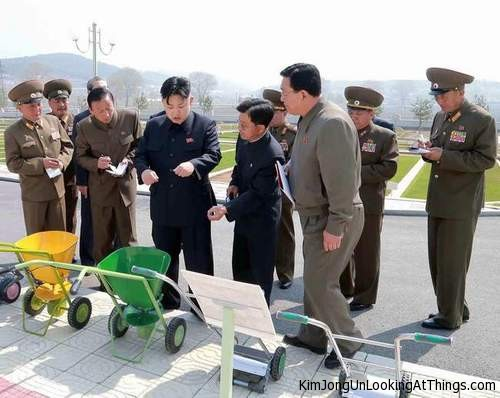 kim jong un looking at fertilizer cart