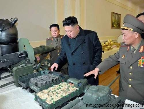 kim jong un looking at model trucks
