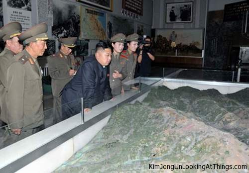kim jong un looking at model mountains