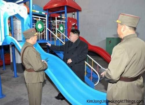 kim jong un looking at slide