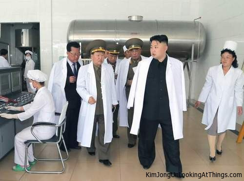 kim jong un looking at factory room