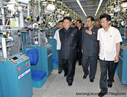 kim jong un looking at factory