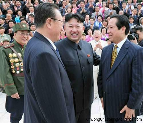 kim jong un looking at kim yang-gon