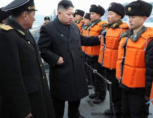 kim jong un looking at life jackets