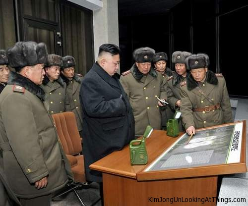 kim jong un looking at maps