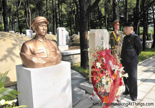 kim jong un looking at memorial