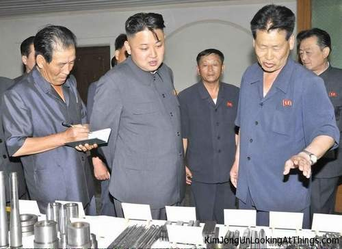 kim jong un looking at metal parts