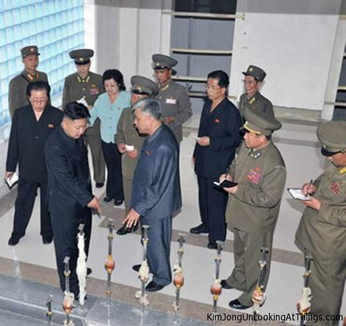 kim jong un looking at railing