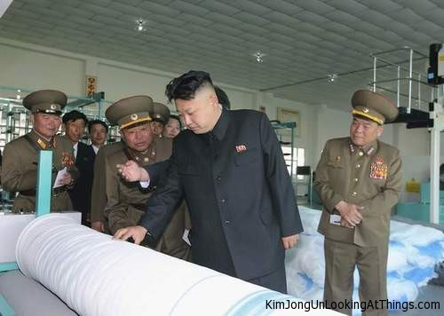 kim jong un looking at roll of plastic
