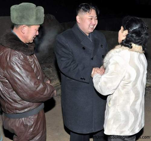 kim jong un looking at woman