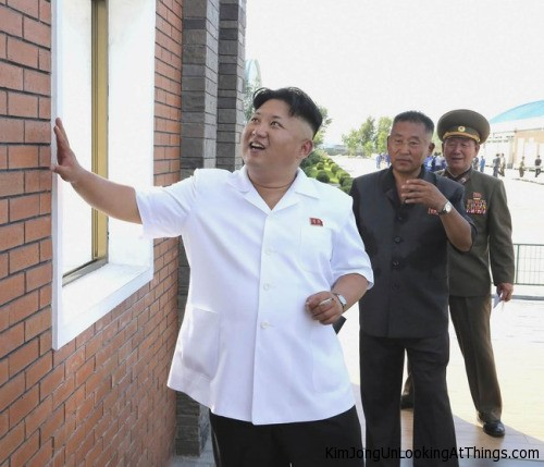 kim jong un looking at bricks