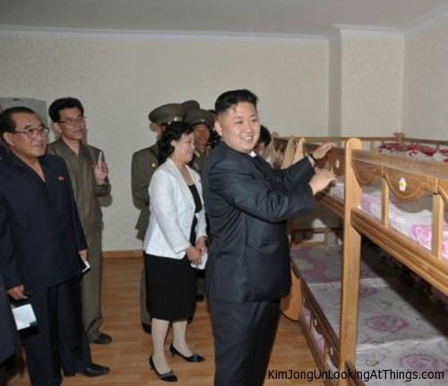 kim jong un looking at bunk bedd