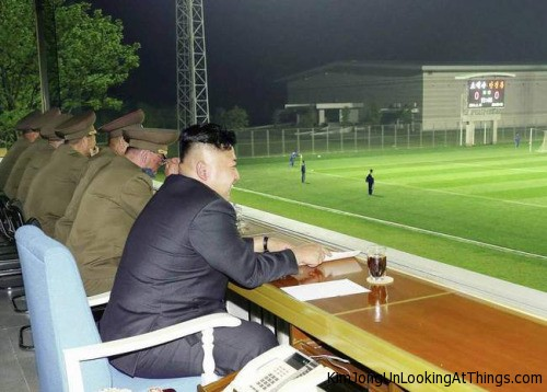 kim jong un looking at soccer game