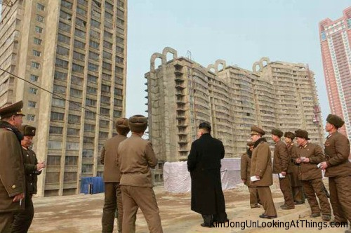 kim jong un looking at tower