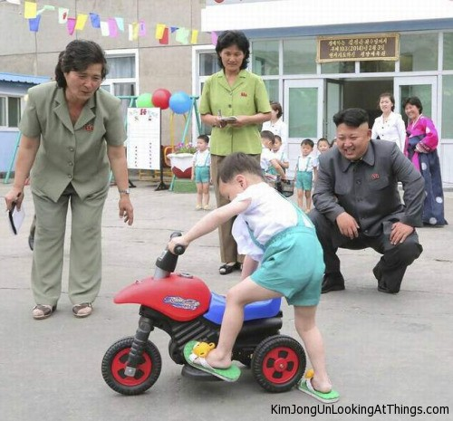 kim jong un looking at toy motorbike